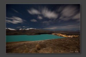 Lake Tekapo and clouds on a moon lit night from Mt John -Photography by Fraser Gunn